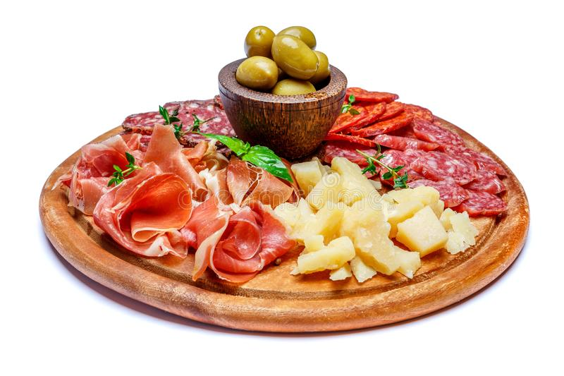 Meat and cheese plate with salami sausage, chorizo, parma and parmesan cheese stock images