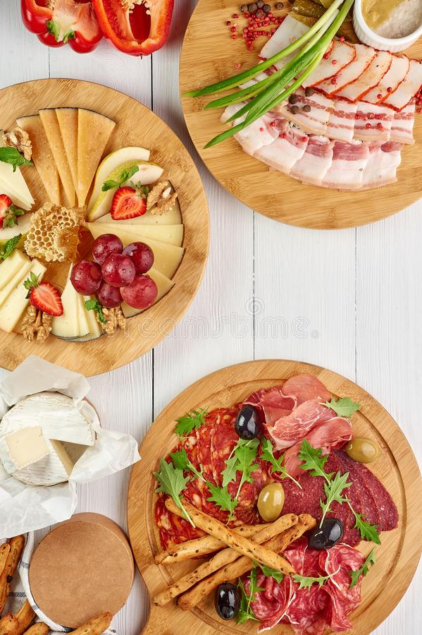 Meat and cheese platter at white wooden table top royalty free stock images