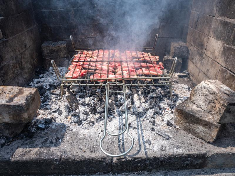 Meat and chicken barbecue in the Basque Country. Grilled, roast, roasted, dinner, food, steak, cooked, meal, herb, meat, restaurant, nobody, dark, garnish stock photography