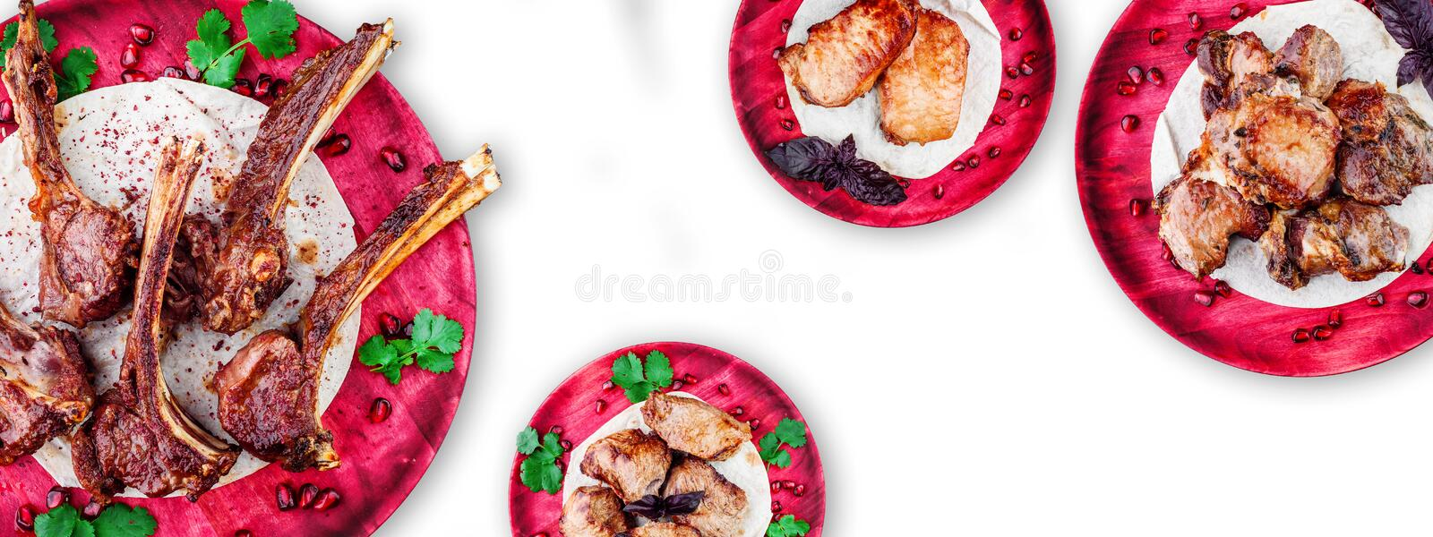 Meat collage. veal ribs, pork, veal and beef barbecue on wooden red plates isolated on a white background. top view. Close up. space royalty free stock photos