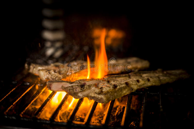 Meat cooked to the fire stock images