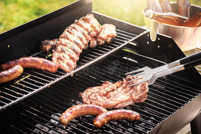Meat cooking on barbecue grill for summer outdoor party. Food ba royalty free stock images
