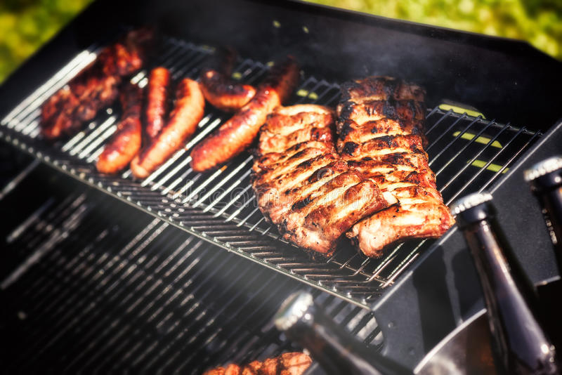 Meat cooking on barbecue grill for summer outdoor party stock photo