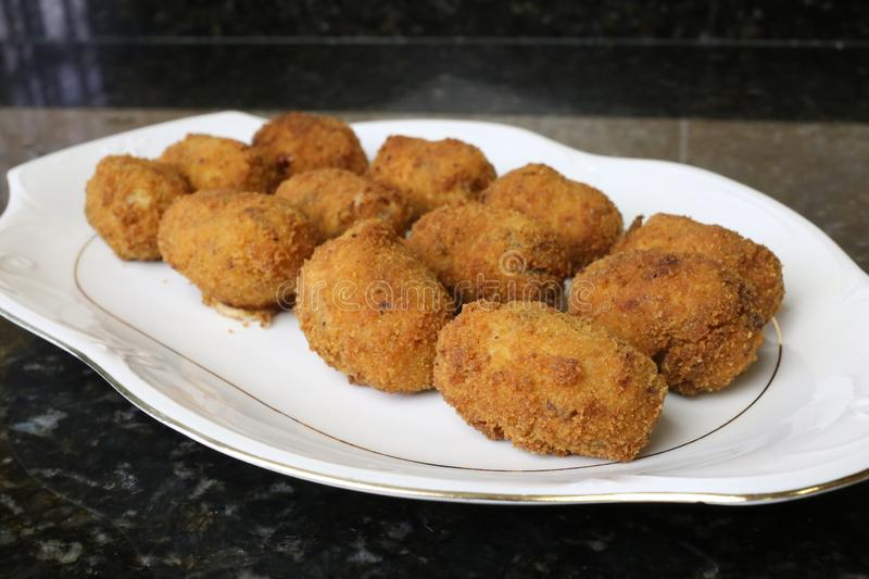 Meat croquette typical food of the Andalusian and Spanish cuisine. Meat croquettes are a typical meal of Andalusian and Spanish cuisine. The croquettes are in stock photography