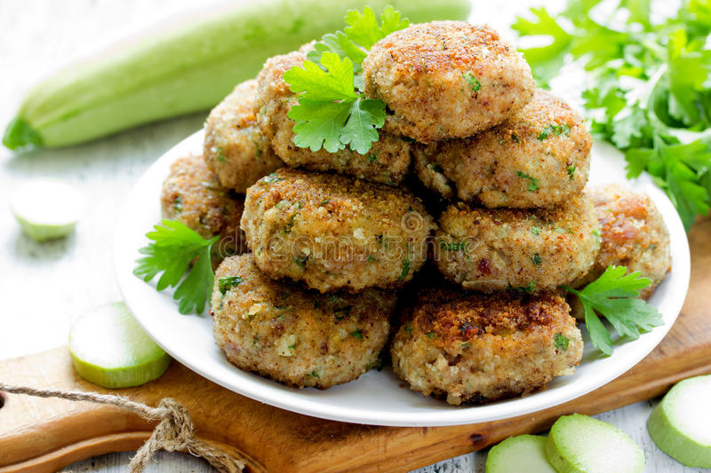 Meat cutlets with zucchini and and green herbs royalty free stock photos