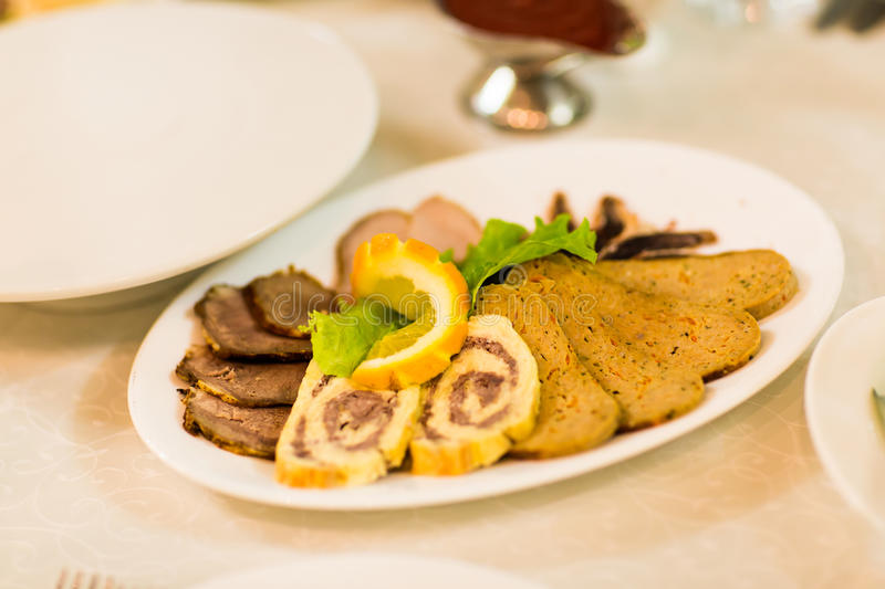 Meat delicatessen plate. On a table at a wedding reception stock images