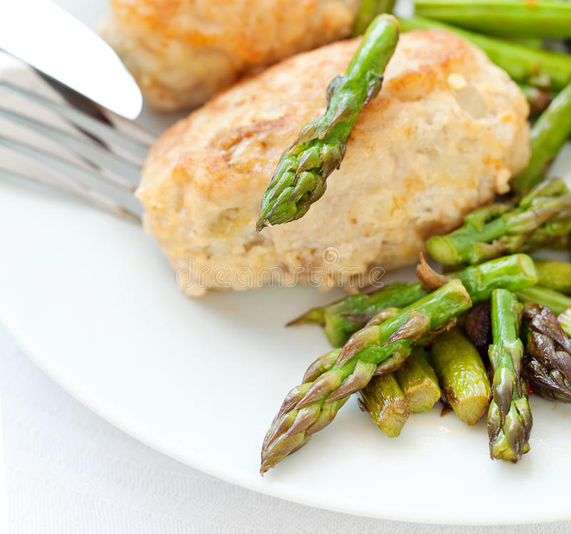 Meat dish. Chicken cutlet with asparagus stock image