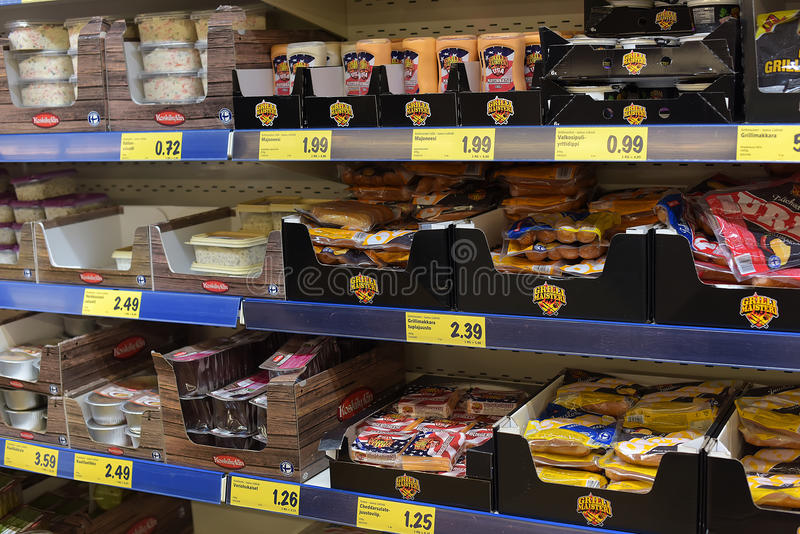 Meat and fish semi-finished products on supermarket shelves stock photo