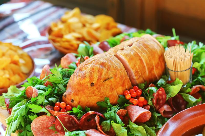 Meat in the form of a pig. Catering Buffet Food Dish with Meat and Colorful vegetables on a Table royalty free stock photography