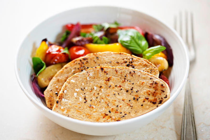 Meat free chicken flavour mycoprotein fillets with grilled vegetables. Meat free chicken flavour mycoprotein fillets with vegetables stock photography