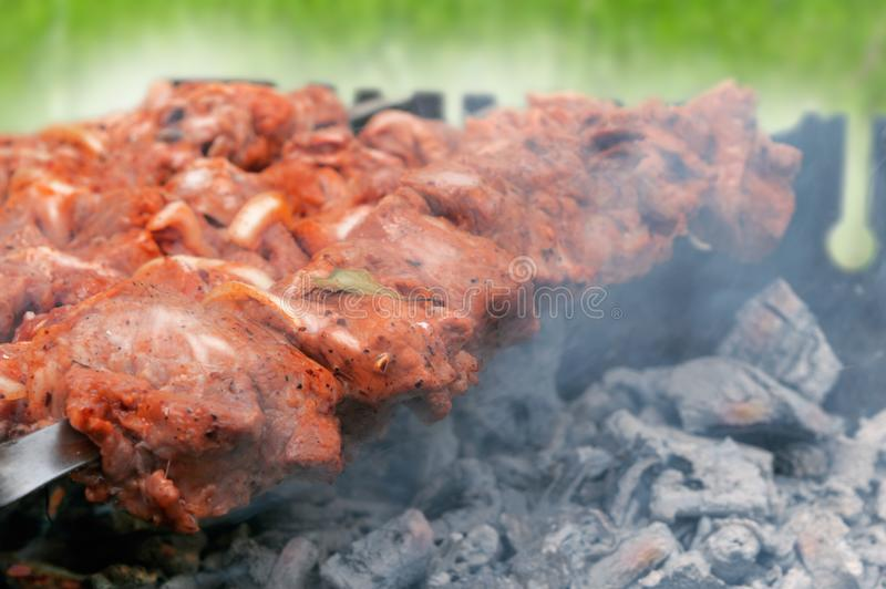 Meat is fried on the grill barbecue stock image
