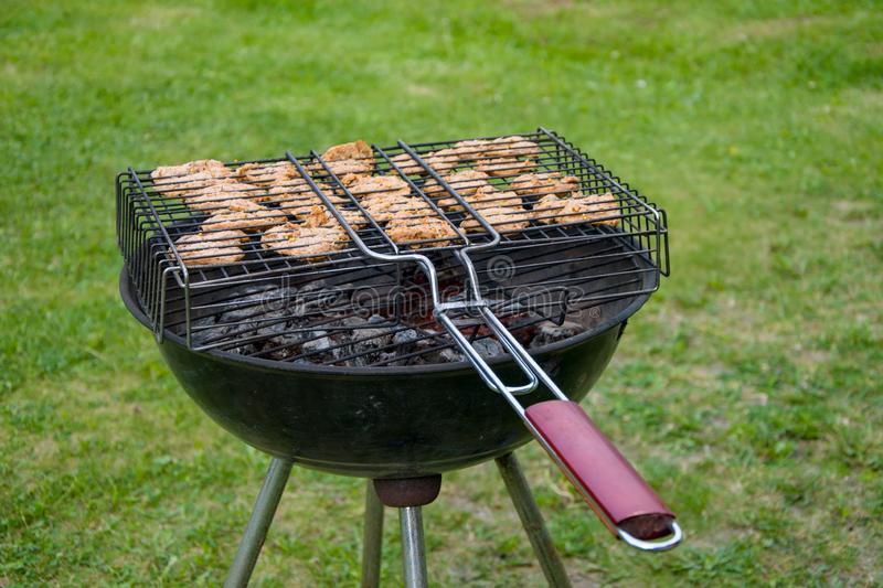 Meat is fried on the grill in the barbecue, the food is cooked on the fire stock photos