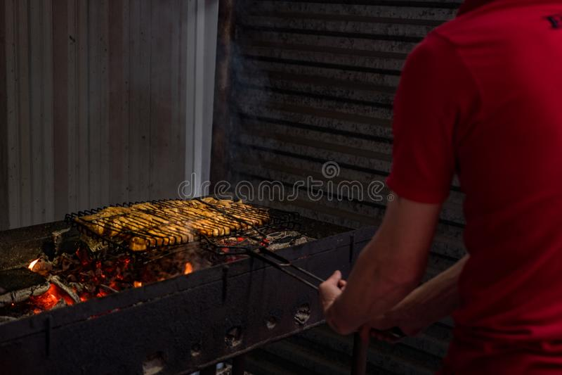 The meat is fried on the grill stock image