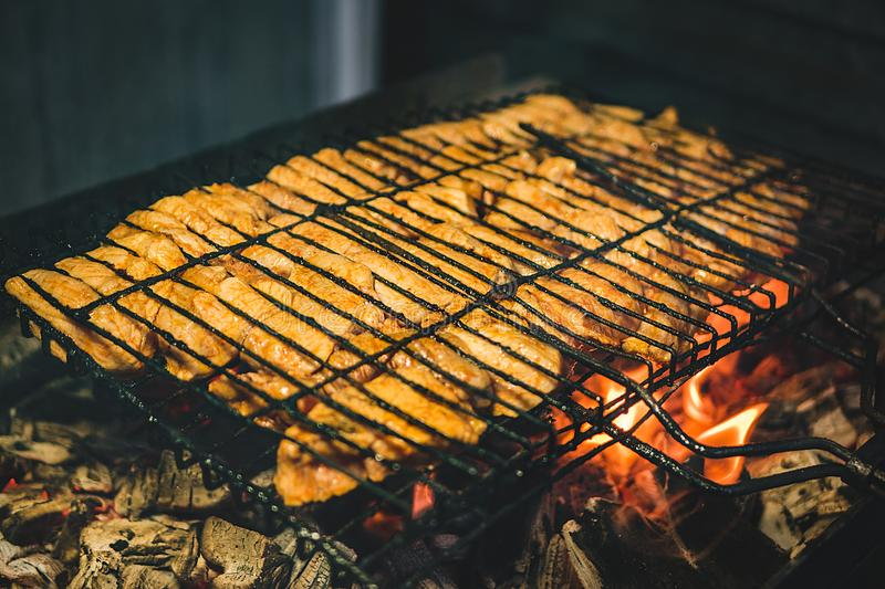 The meat is fried on the grill royalty free stock image
