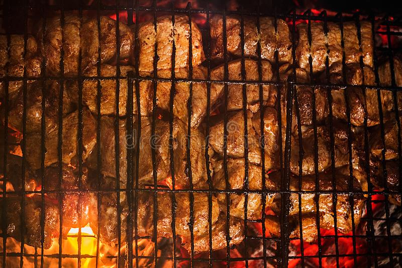 The meat is fried on the grill royalty free stock images