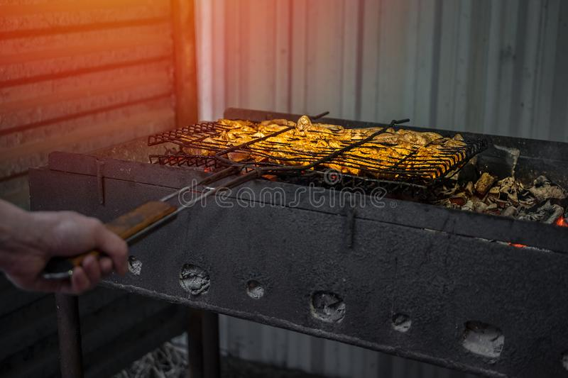 The meat is fried on the grill stock photo
