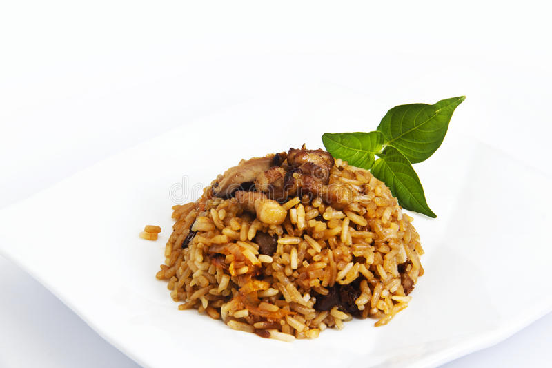 Meat fried rice. With leaf on the plate stock images