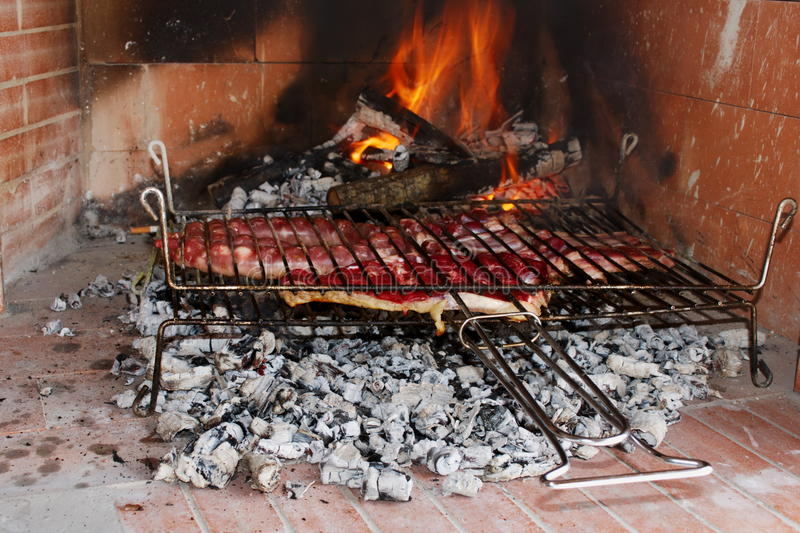 Meat on the grill. Raw meat just put on the barbecue to cook royalty free stock photography