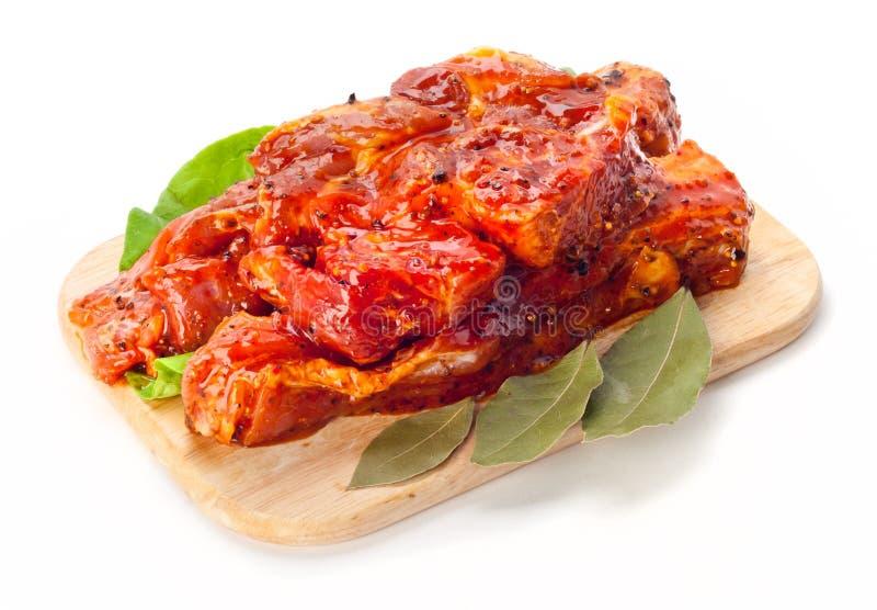 Meat i marinad arkivfoto