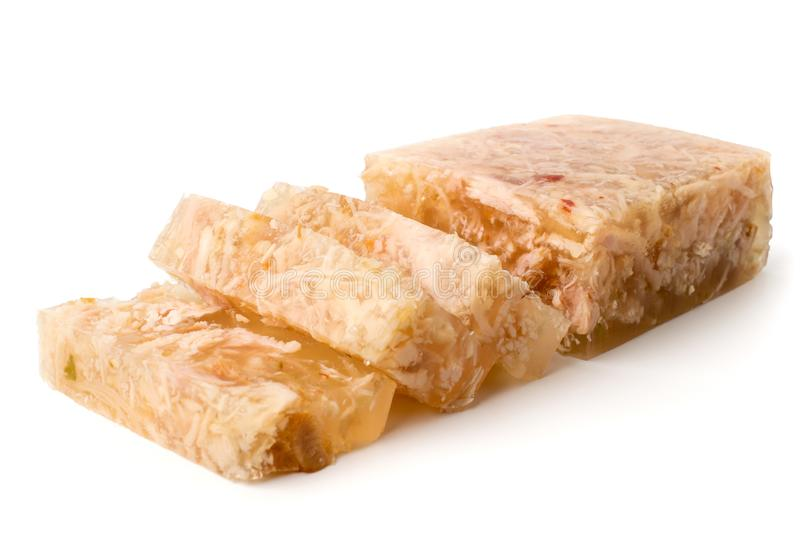 Meat jelly cut in slices on a white, closeup. stock images