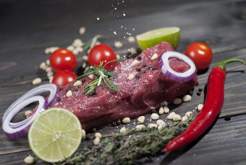 Meat with vegetables. A piece of meat with vegetables and lemon and Provencal herbs stock image