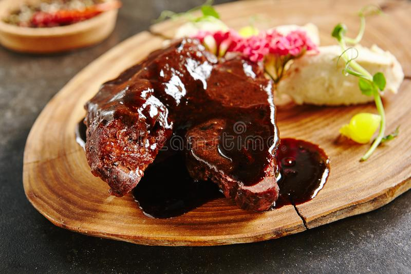 Roasted Mutton on Rustic Wooden Background stock image