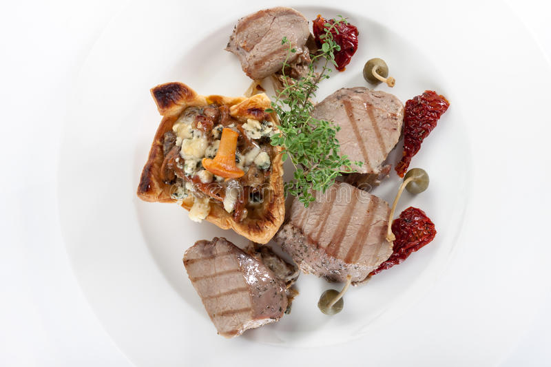 Meat with mushrooms on a white plate royalty free stock photo