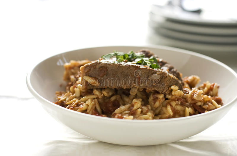 Meat with orzo pasta royalty free stock photography