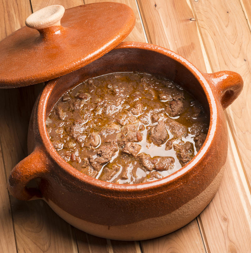 Meat with pepper in the pot stock photography