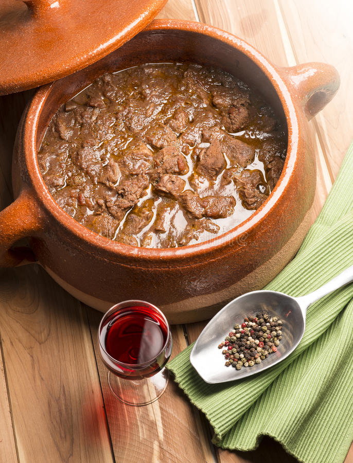 Meat with pepper in the pot stock photo