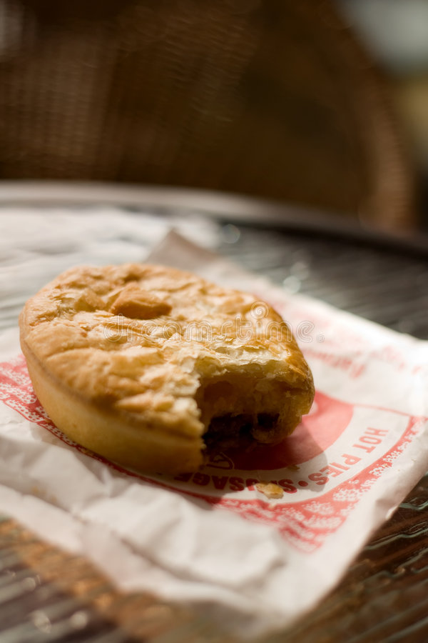 Meat pie. A tasty meat pie sitting on a table in the sunlght royalty free stock images