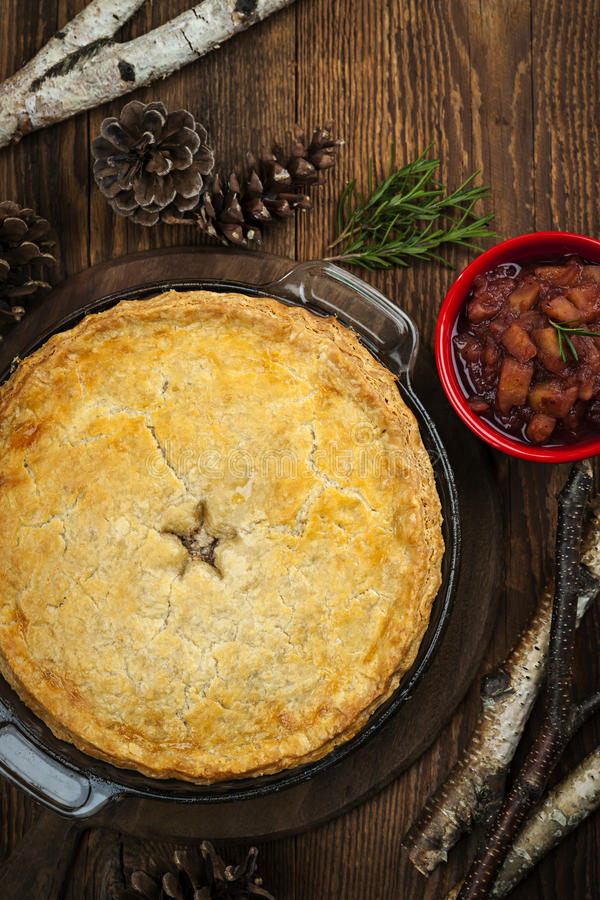 Meat pie Tourtiere. Traditional pork meat pie Tourtiere with apple and cranberry chutney from Quebec, Canada, top view stock photos