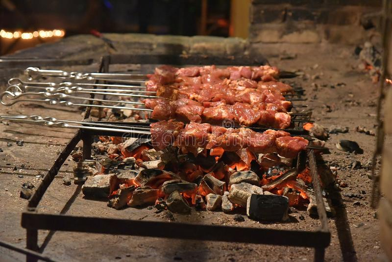 Meat pierced with skewers at the stake royalty free stock photo