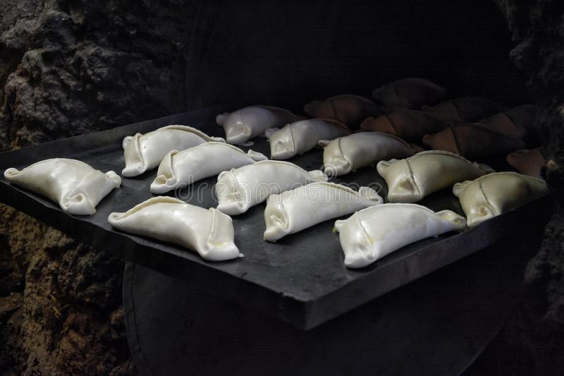 Meat pies on the baking tray royalty free stock photo