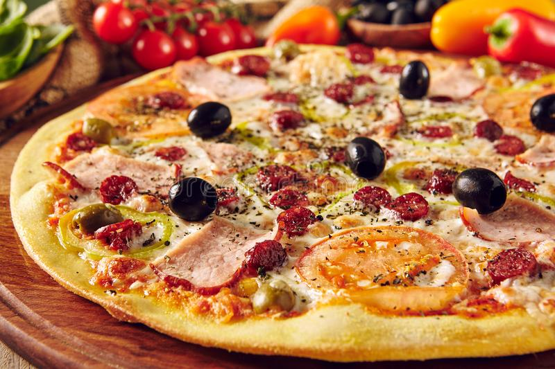 Meat pizza on wooden table close up royalty free stock images