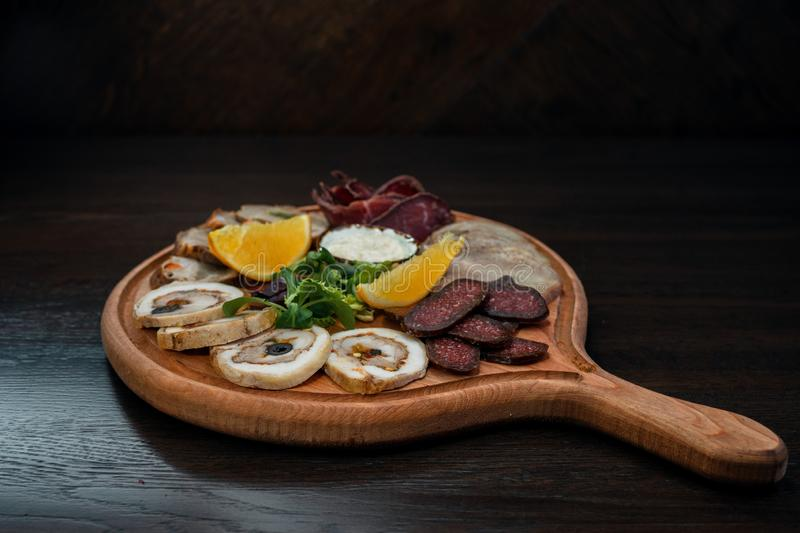 Meat platter on a wooden board in a restaurant of Georgian cuisine. Appetizing snack. stock images