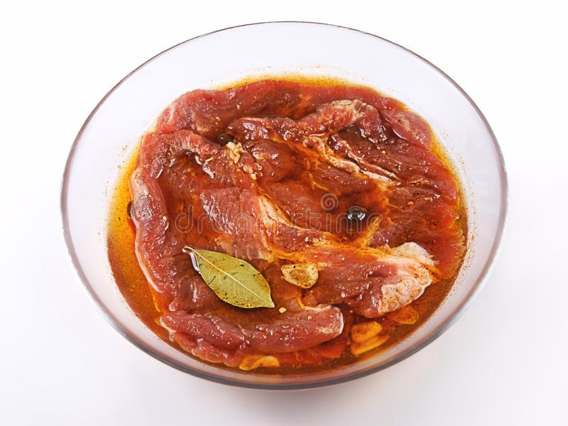 Meat, Pork in marinade on a glass plate royalty free stock images