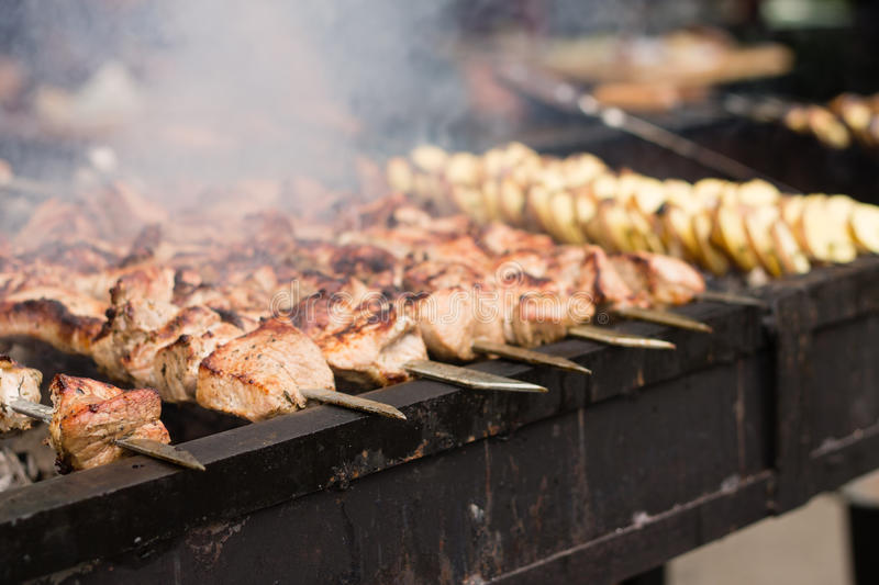 Meat and potato on grill stock images