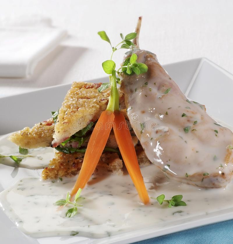 Meat and potato pancakes in bechamel sauce royalty free stock images