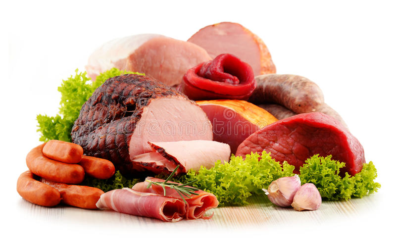 Meat products including ham and sausages on white. Assorted meat products including ham and sausages on white background stock images