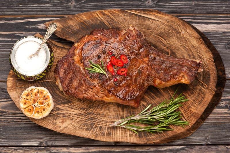 Meat Ribeye steak. Top view. Ribeye steak with rosemary and garlic stock photos