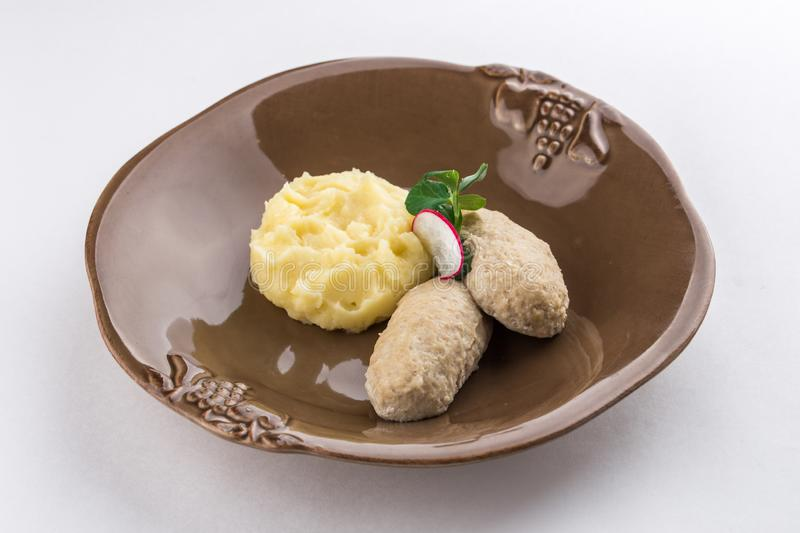 Meat rissoles with mashed potato isolated on white background stock photography