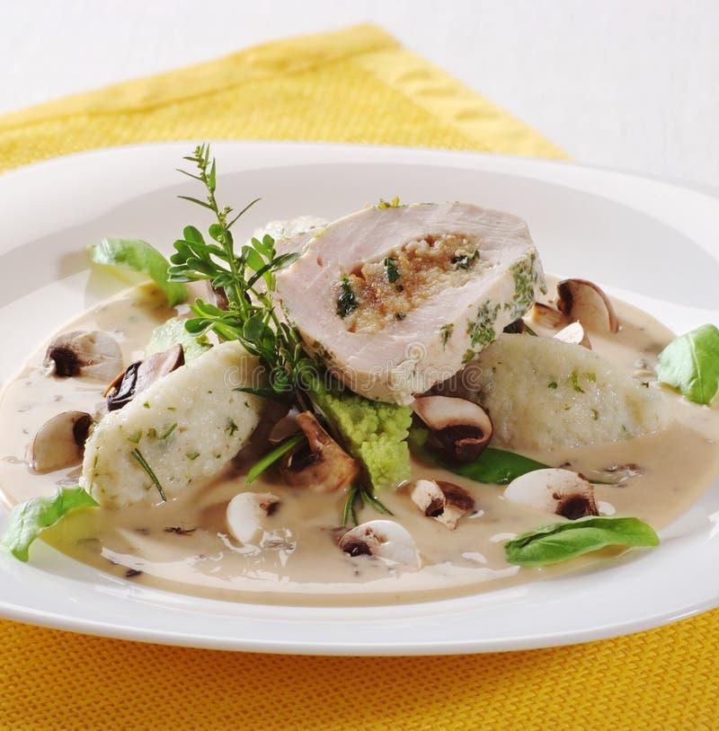 Meat roll and potato dumplings in mushroom sauce. Slice of meat roll and potato dumplings in mushroom sauce royalty free stock image