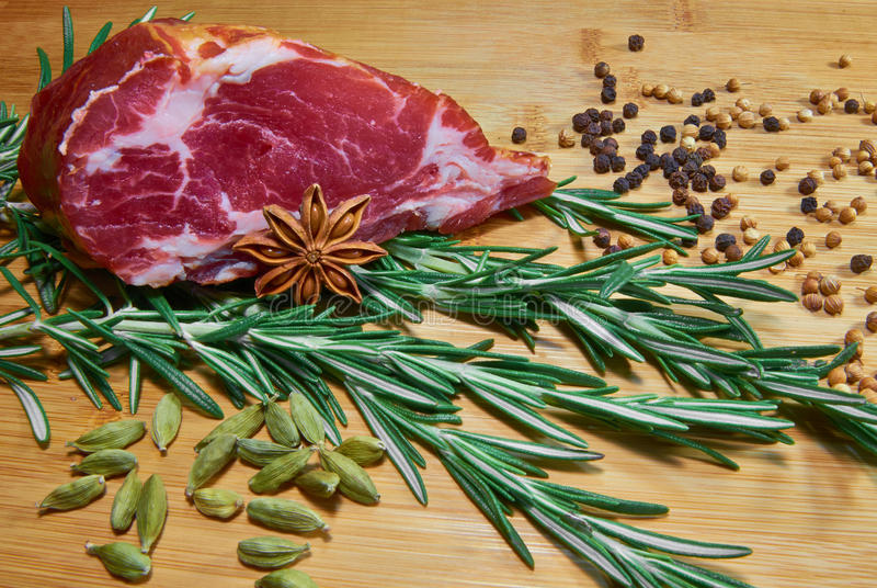 Raw meat with rosemary and coriander stock photos