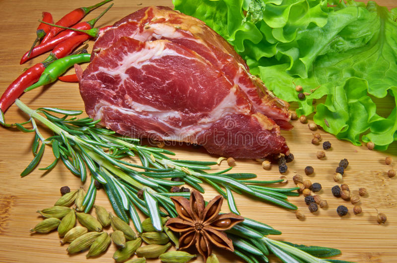 Raw meat with rosemary stock images