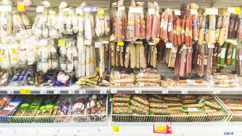 Meat and salami on shelf in Carrefour supermarket, Piatra Neamt, Romania. PIATRA NEAMT, ROMANIA - DECMBER 16, 2016: meat and salami on shelf in Carrefour stock photos