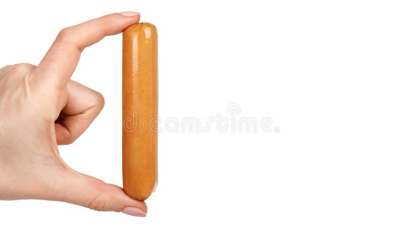 Meat sausage for hot dog or barbecue in hand. Isolated on white background. Fast food meal.  stock photography