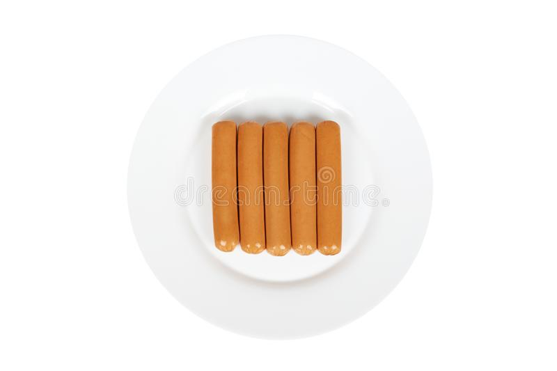 Meat sausage for hot dog or barbecue on plate. Isolated on white background. Fast food meal.  royalty free stock image