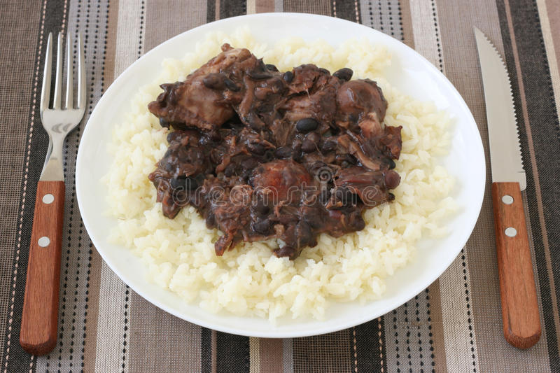 Meat With Sausages And Beans On Rice Royalty Free Stock Photography