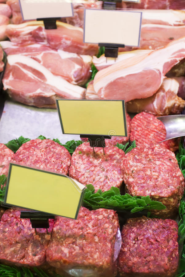 Meat and sausages in a butcher shop royalty free stock photography